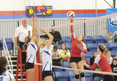 Rio Grande's Ally Hawkins goes airborne for a return during Saturday's MSC Tournament semifinal loss to Lindsey Wilson