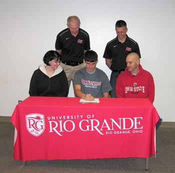 River Valley's Justin Mabe signs with Rio Grande as his parents and members of the Rio coaching staff look on