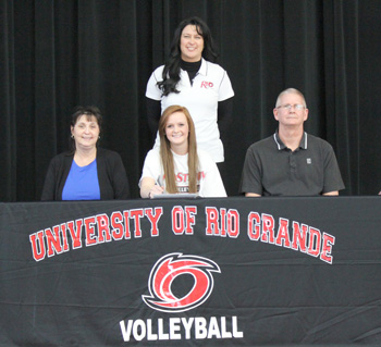 Jackson High's Sarah Martin poses with her parents and Rio coach Billina Donaldson after signing with the RedStorm