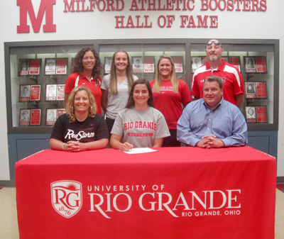 Milford High�s Katie Noll poses with her family and coaches and signing to continue her softball career at Rio Grande