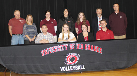 Vinton County High's Caitlyn Owings poses with family, coaches and administrators after signing with Rio Grande