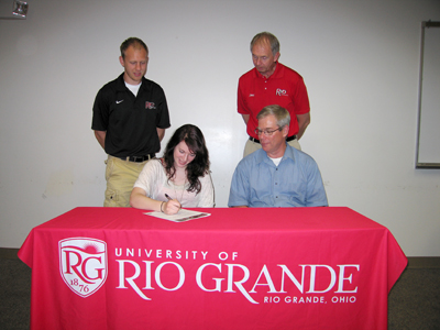Jessica Reckner is joined by her father, Bill, and Rio Grande coaches as she signs to run for the RedStorm
