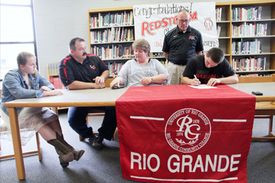 Lawrence County High's Clark Rice signs to play baseball at Rio Grande as his family and Rio head coach Brad Warnimont watch