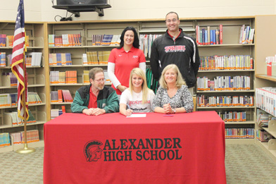Alexander High School's Jonnalyn Shimko poses with her parents and coaches after signing to play volleyball at Rio