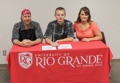 Boyd County (Ky.) High School's Jaz Stephenson poses with parents before signing to play soccer at Rio Grande