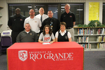Valley High School's McKenzie Coriell poses with her parents, coaches and administrators after signing with Rio Grande