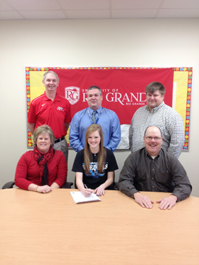 Gallia Academy's Morgan Foster poses with her parents, coaches and administrators after signing with Rio Grande