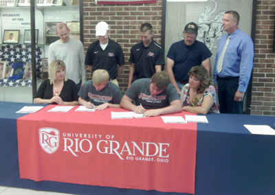 Morgan High School's Clinton Campbell (center left) and Derek Dingey (center right) sign with Rio Grande