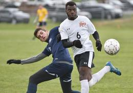 Rio's Joao Paulo Antonio and St. Thomas' Breno Ertty battle for the ball during Saturday's NAIA tourney game