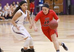 Rio's Sharday Baines drives past Cincinnati Christian's Brittany Wells for two of her 10 points in Saturday's 96-75 win over