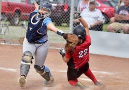 Rio's Kelsey Conkey scores ahead of the tag from Shawnee State catcher Miranda Melvin in Tuesday's game two win