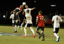 Rio's Gerard McGahey and Davenport's Cam Cavanagh battle for control of the ball in Friday night's NAIA semifinal match